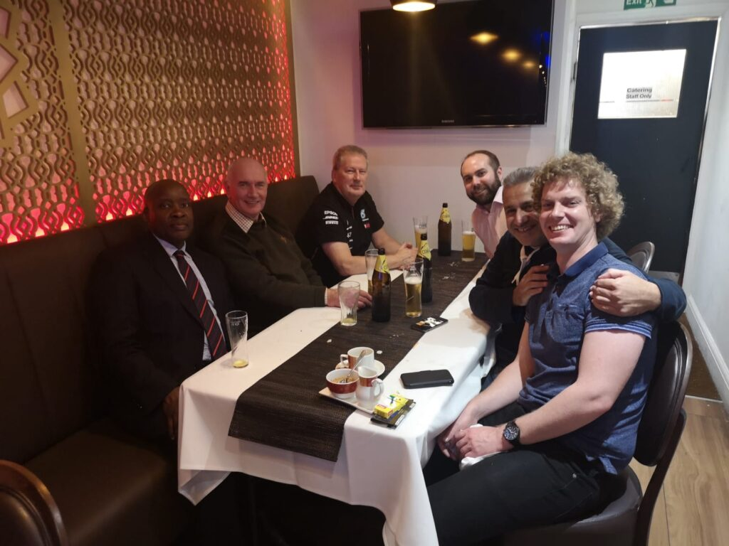 Photo is of 6 members of the Lodge who gathered for a meal at K5 a local curry restaurant  in Pinner