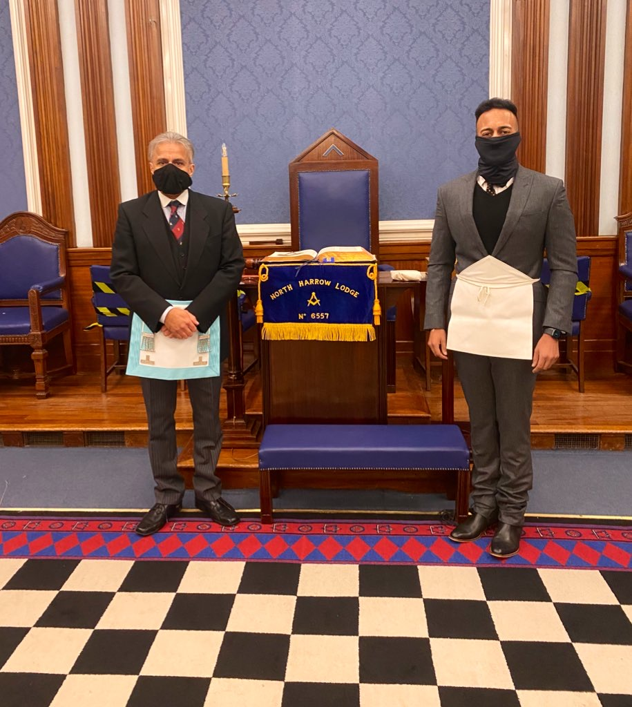This photo is of the initiate Manjeave and the Worshipful Master Kam